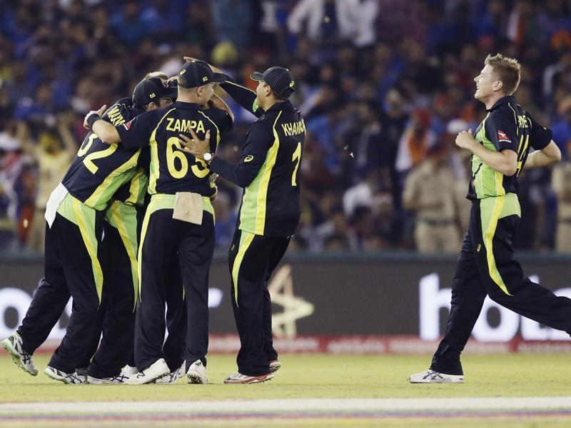 Australia's Shane Watson is congratulated by teammates after dismissing India's Yuvraj Singh. (AP)