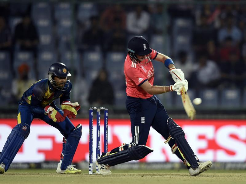 Jason Roy hits a shot as Dinesh Chandimal watches. (Sanjeev Verma/HT Photo)