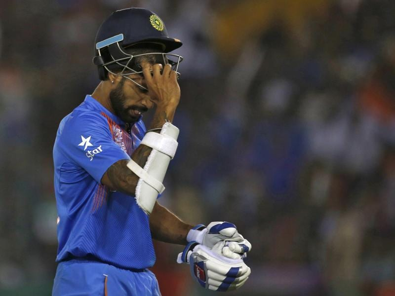 Shikhar Dhawan walks off the field after his dismissal. (REUTERS)