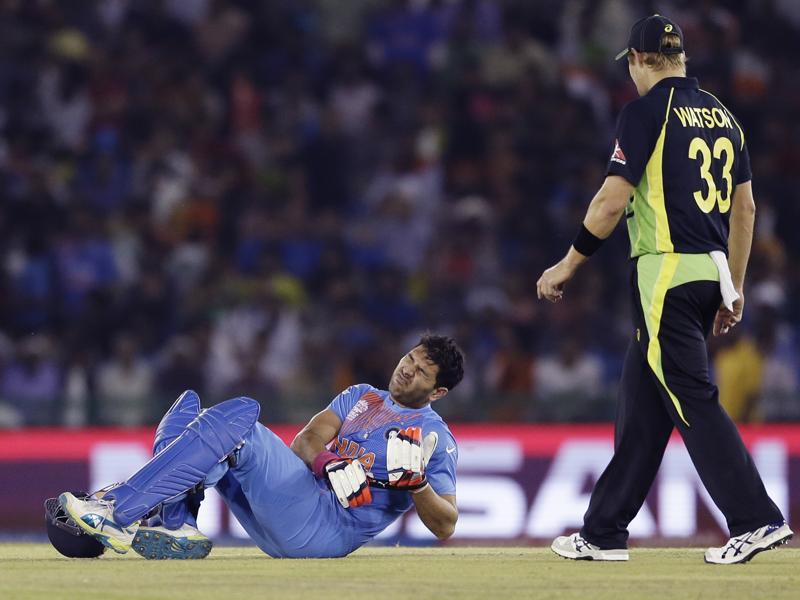 Yuvraj Singh lies down on the field after twisting his ankle as Shane Watson looks on. (AP)