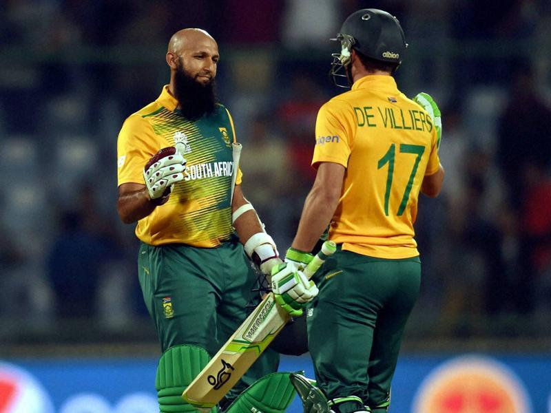 South African batsmen Hashim Amla and AB De Villiers celebrate after victory over Sri Lanka during the ICC World T20 match at Feroz Shah Kotla Stadium in New Delhi on March 28, 2016. (PTI)
