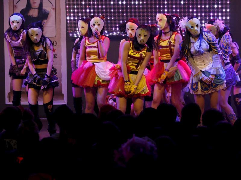 Japanese idol group Kamen Joshi (Masked Girls) perform during a concert at their theatre in Tokyo's Akihabara district, Japan. (REUTERS)