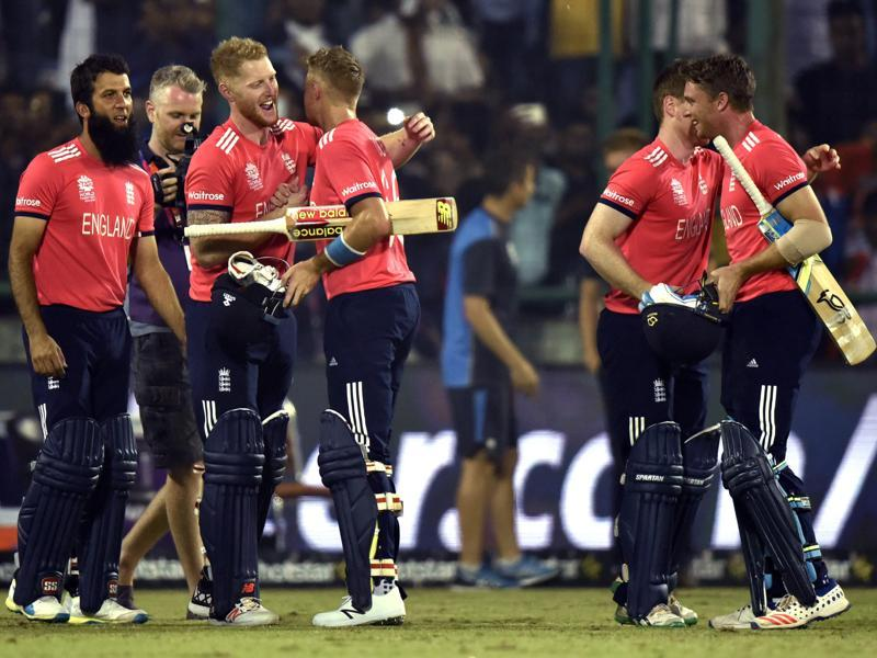 Jos Buttler and Joe Root of England congratulated by teammates after England beat New Zealand in the ICC World T20 semifinal at the Feroz Shah Kotla Stadium in New Delhi on March 30, 2016. (Virendra Singh Gosain/HT Photo)