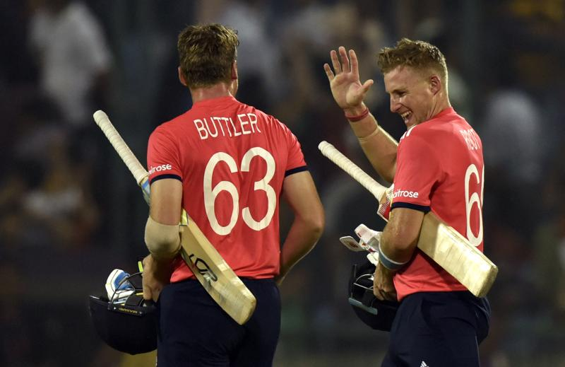 Jos Buttler and Joe Root exchange high fives after their win. (Virendra Singh Gosain/HT Photo)