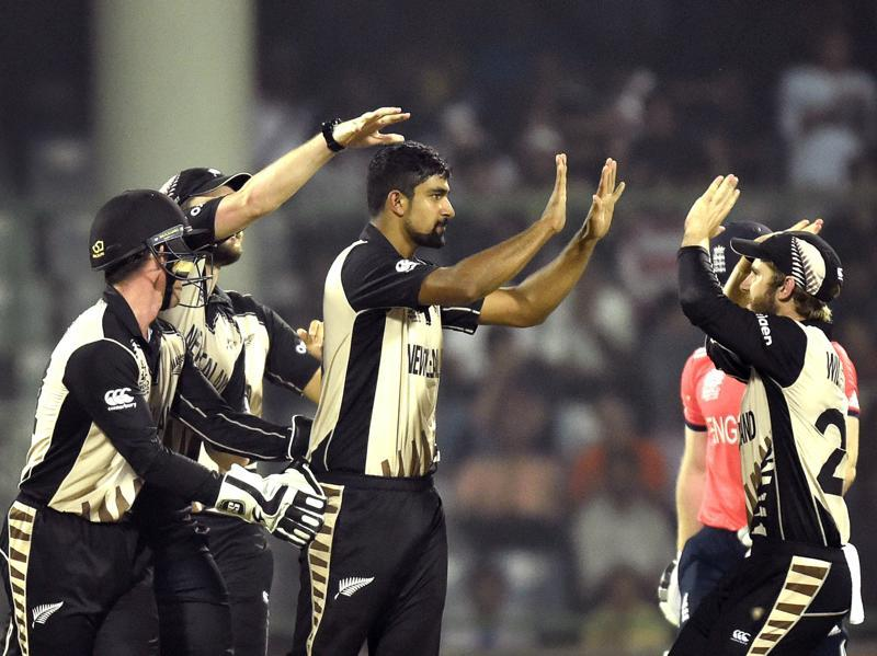 Ish Sodhi is congratulated by team members after dismissal of England player Eoin Morgan. (Ajay Aggarwal/HT Photo)