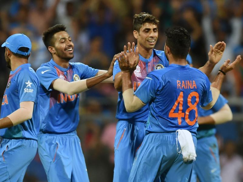 India's Ashish Nehra with his team mates celebrates the wicket of West Indies Marlon Samuels. (Kunal Patil/HT Photo)