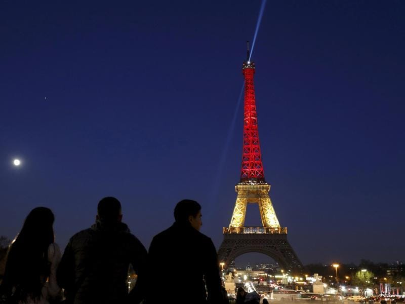 The Eiffel Tower lit up again, this time in the black, yellow and red colours of the Belgian flag, to pay tribute to the victims of bomb attacks in Brussels on March 22, 2016. (REUTERS)