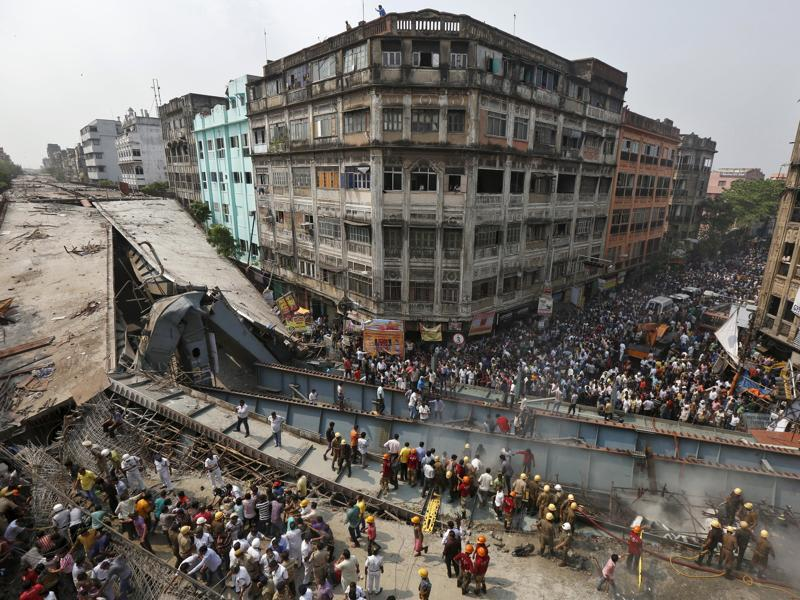 Firefighters and rescue workers search for victims at the site of an under-construction flyover after it collapsed in Kolkata. (Reuters Photo)