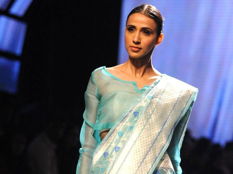 A model sports a Swati & Sunaina creation, who explored an organic line infused with elements from the life of mythological character Radha. Their collection is a sensuous line of gossamer creations handloomed with precision.  (AFP)