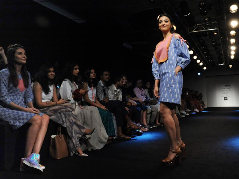 Actor Mandana Karimi (L) cheers as fellow actor Radhika Apte (R) poses on the opening day of the Lakme Fashion Week (LFW) in Mumbai on Thursday. (AFP)
