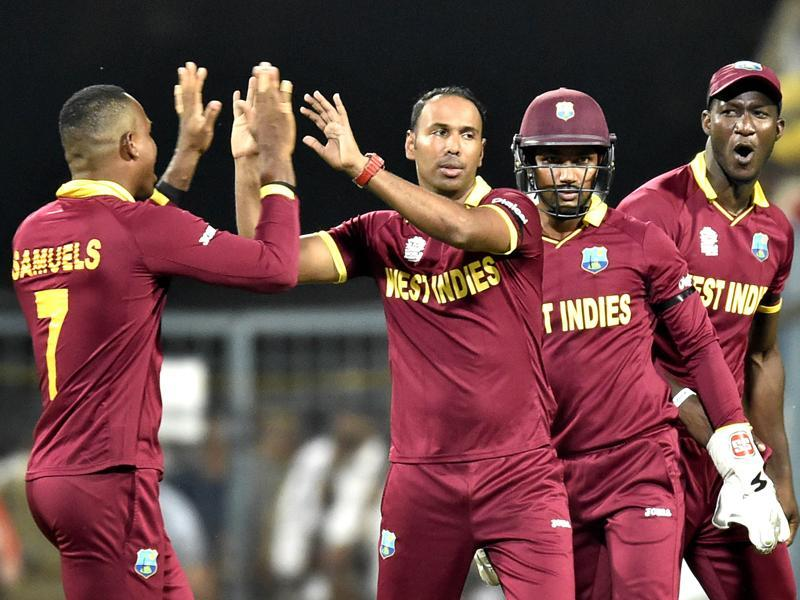 West Indies bowler Samuel Badree being congratulated by team mates. (Ajay Aggarwal/HT Photo)