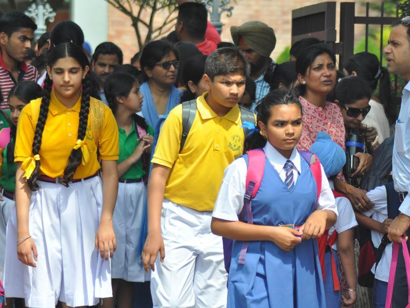 Students come out after the first day of school in the new session in Chandigarh on Monday. (karun sharma/HT photo)