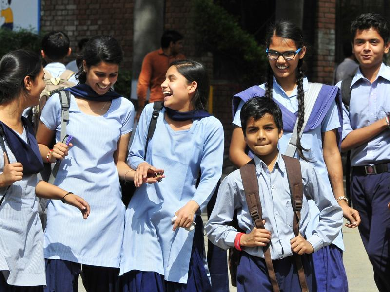 Students appeared happy to be back after schools reopened in Chandigarh on Monday. (keshav singh/ht photo)