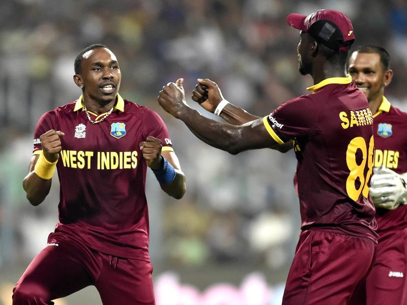 West Indies bowler Dwayne Bravo being congratulated by team mates. (Ajay Aggarwal/HT Photo)
