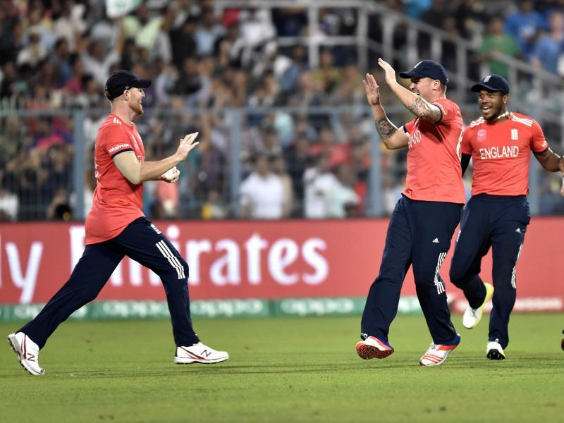 England player Joe Root and others celebrates the dismissal of West Indies batsman Chris Gayle. (Ajay Aggarwal/HT Photo)