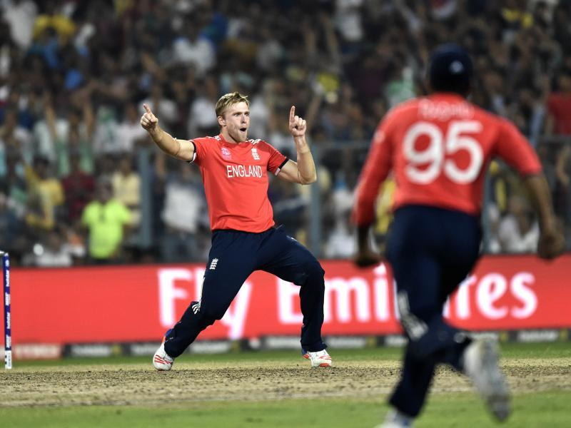 England team player David Willey celebrates the dismissal of West Indies batsman Andre Russell. (Ajay Aggarwal)