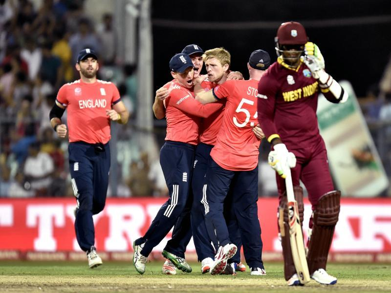 England player David Willey celebrates the dismissal of West Indies batsman Lendl Simmons. (Ajay Aggarwal/HT Photo)