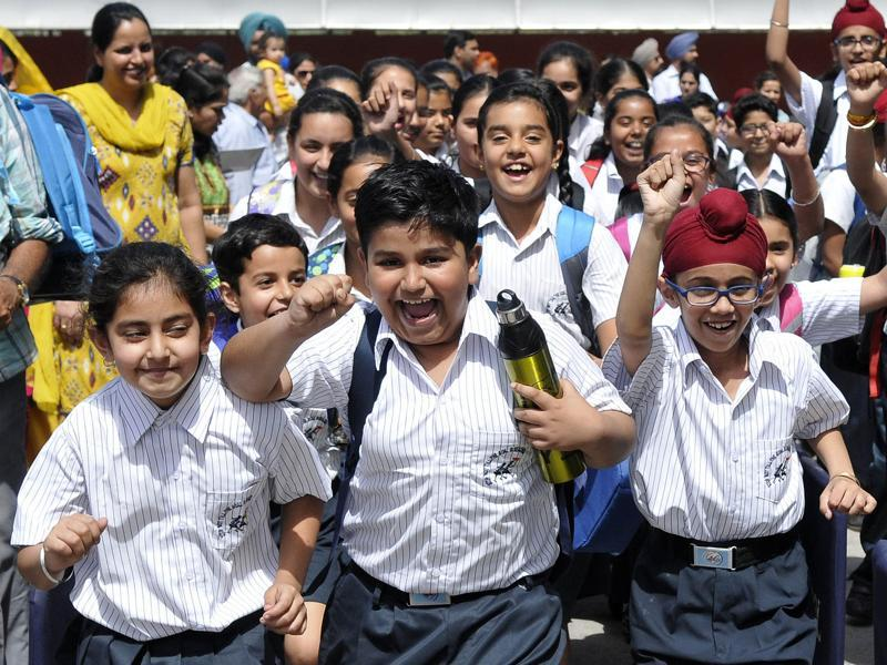 Students come out after the first day of school in the new session in SAS Nagar (Mohali) on Monday. (Gurminder Singh/HT photo)