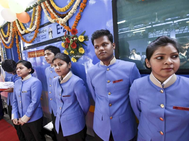 As melodies floated through the air at the station, train stewards and hostesses welcomed the passengers with roses on board the Gatimaan Express. (Arun Sharma / HT Photo)