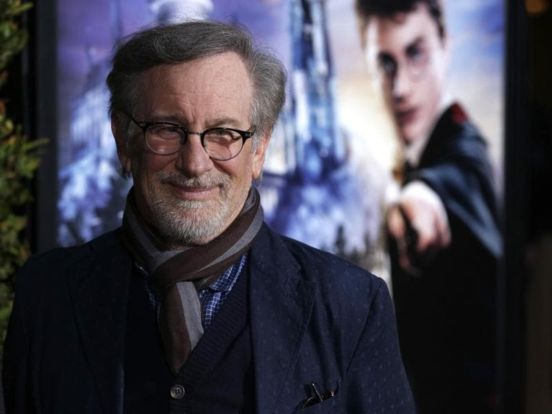 Director Steven Spielberg poses as he arrives for a special preview opening of The Wizarding World of Harry Potter in Universal City, California. (REUTERS)