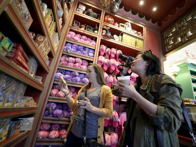 Guests look at a display of candy inside the Honeydukes sweets shop in Hogsmeade Village during a soft opening and media tour of The Wizarding World of Harry Potter theme park at the Universal Studios Hollywood in Los Angeles. (REUTERS)