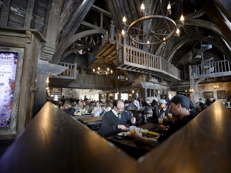 Guests eat lunch inside Three Broomsticks, an aged rustic tavern, in Hogsmeade Village during a soft opening and media tour of The Wizarding World of Harry Potter theme park at the Universal Studios Hollywood in Los Angeles, California. (REUTERS)