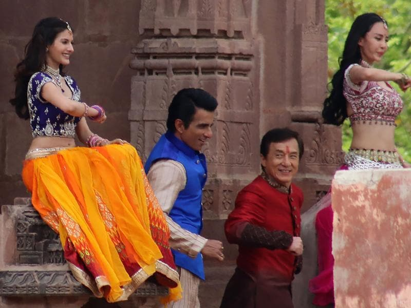 Jackie Chan, Sonu Sood and actress Amrya Dastur dance on set with other performers as they shoot a scene of the forthcoming film Kung Fu Yoga. (AFP)