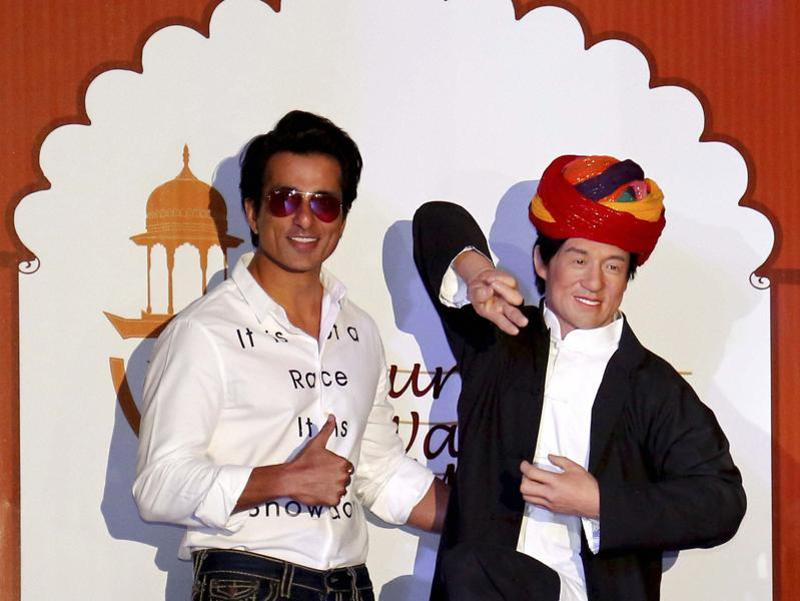 Actor Sonu Sood poses with a wax statue of Hollywood superstar Jackie Chan after unveiling it at Nahargarh Fort Museum in Jaipur on Tuesday.  (PTI)