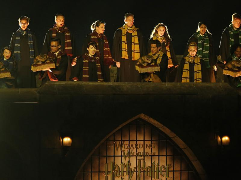 Performers sing during a special preview opening of The Wizarding World of Harry Potter attraction at Universal Studios Hollywood in Universal City. (REUTERS)