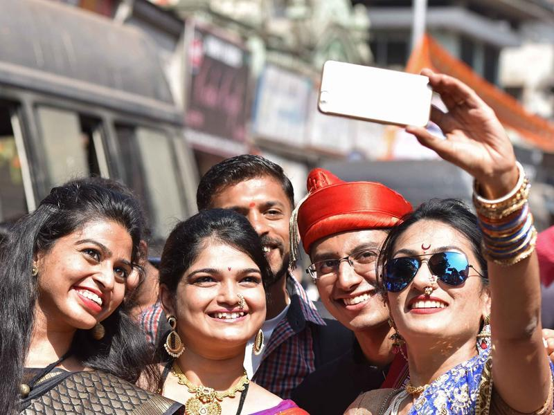 Youngsters take selfie duing Gudi Padwa procession at Girgaum in Mumbai on Friday.  (Pratham Gokhale/ Hindustan Times)
