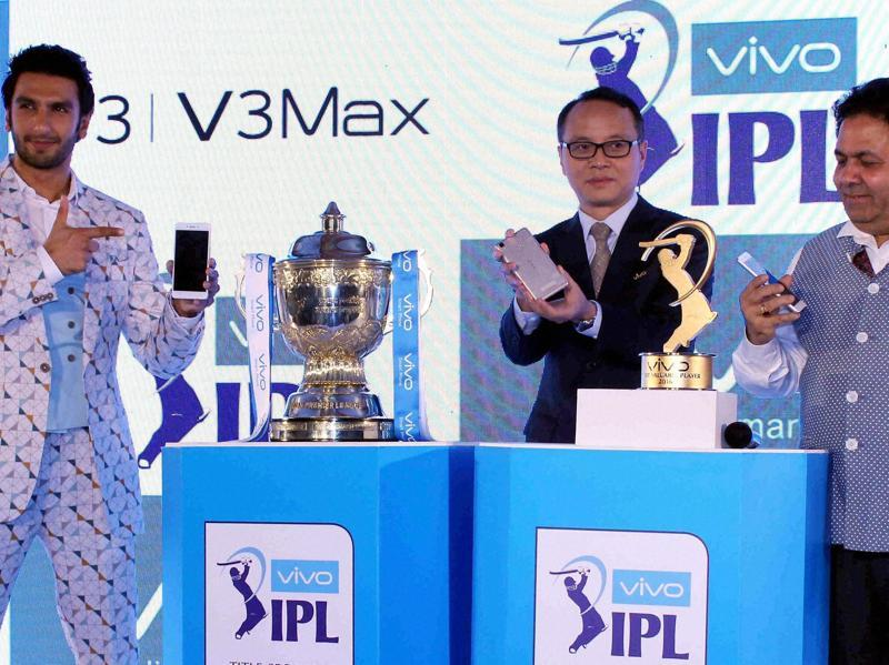 Actor Ranveer Singh, Alex Feng, CEO of VIVO India, and IPL Chairman Rajiv Shukla pose with newly launched VIVO smart phones and the IPL trophy in Mumbai on April 5, 2016. (PTI)