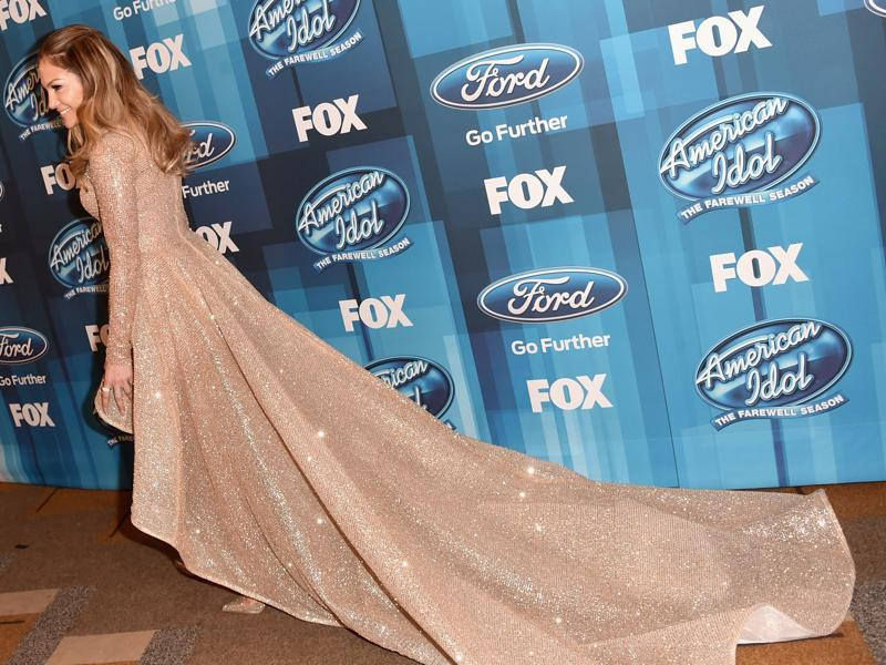 Actor and singer Jennifer Lopez stuns in a golden gown... (AFP)