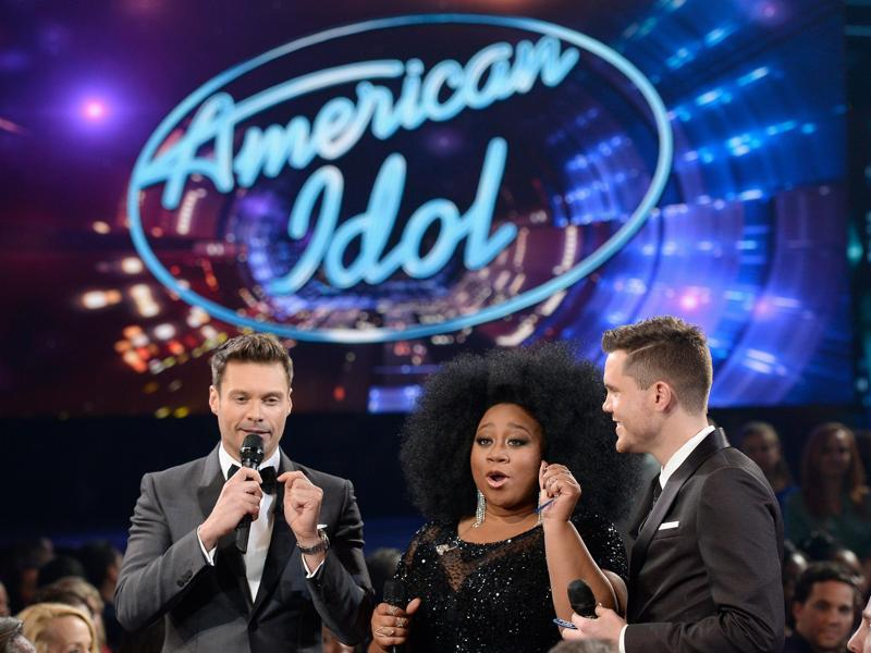 Popular American music talent hunt television series, American Idol, had its final show on Thursday in Los Angeles, California amid much fanfare and emotional moments. (L-R) Host Ryan Seacrest and finalists La'Porsha Renae and Trent Harmon speak onstage during FOX's American Idol Finale For The Farewell Season on April 7, 2016 in Hollywood, California.  (AFP)