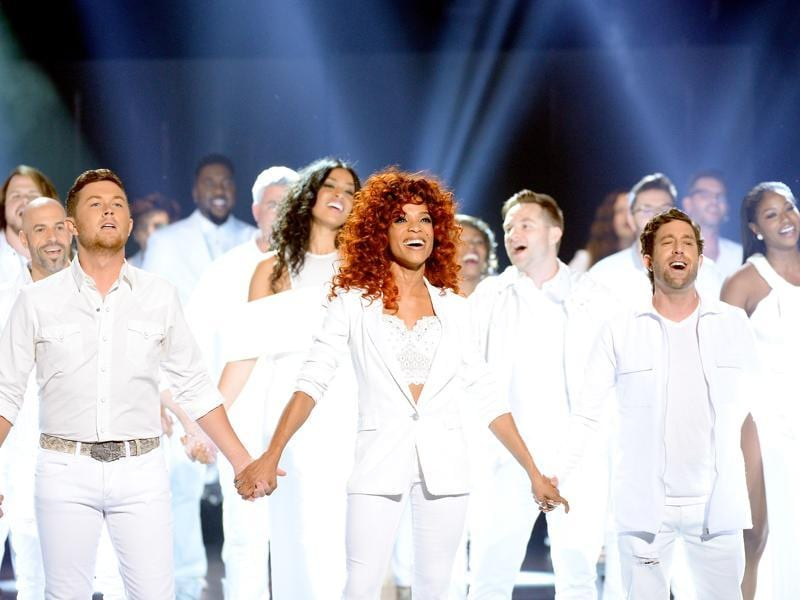 The show saw the return of dozens of singers who became famous through the TV series. Past winners and finalists perform together onstage. (AFP)