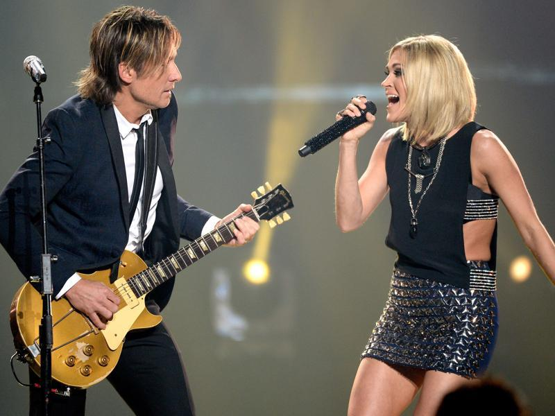 Recording artists Keith Urban (L) and Carrie Underwood perform onstage during the finale. Carrie  rose to fame after winning the fourth season of American Idol in 2005. (AFP)