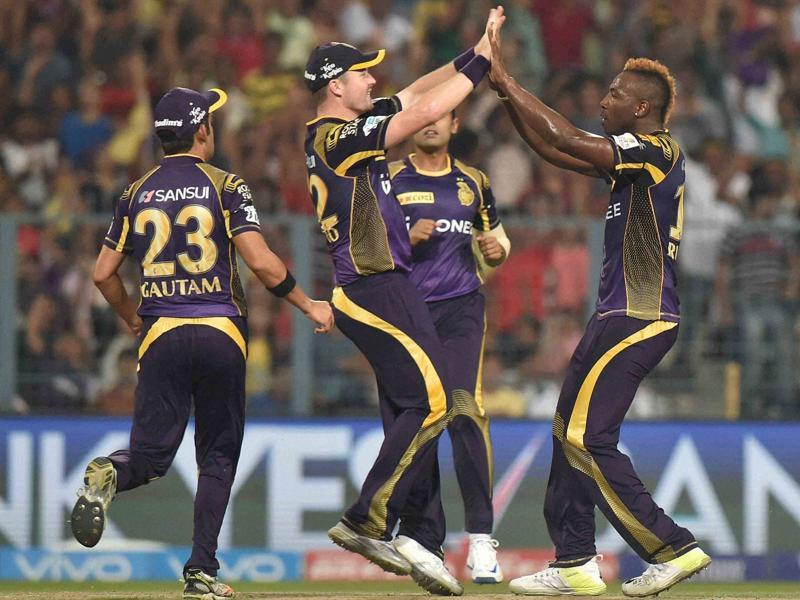 KKR bowler Andre Russell celebrate with team mates after taking a wicket. (PTI Photo)