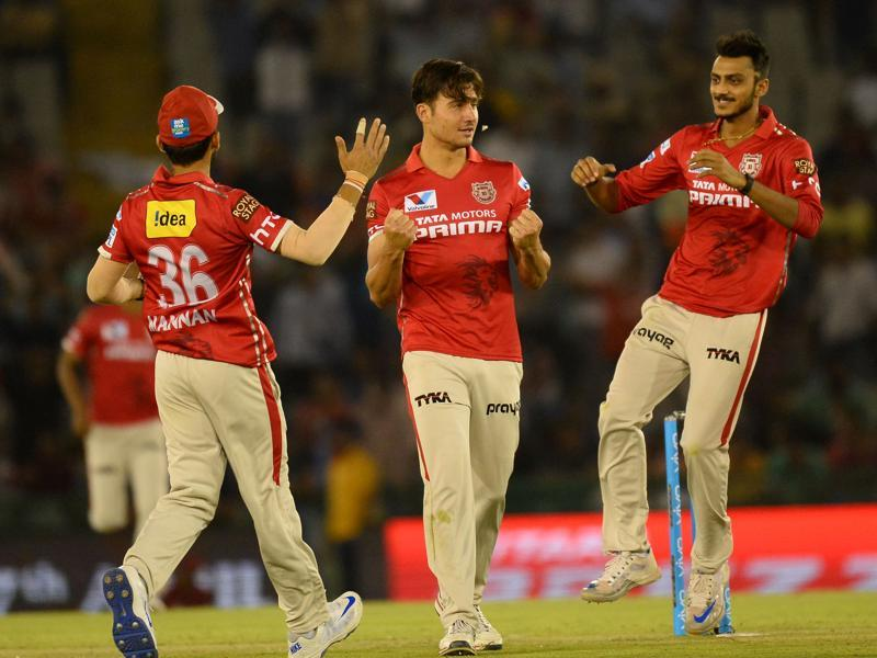 Kings XI Punjab Marcus Stoinis (C) celebrates with teammates after dismissing Gujarat Lions team captain Suresh Raina. (AFP Photo)