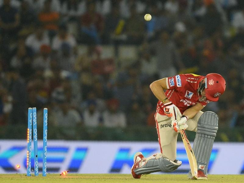 Kings XI Punjab batsman David Miller is bowled by Gujarat Lions Dwayne Bravo. (AFP Photo)