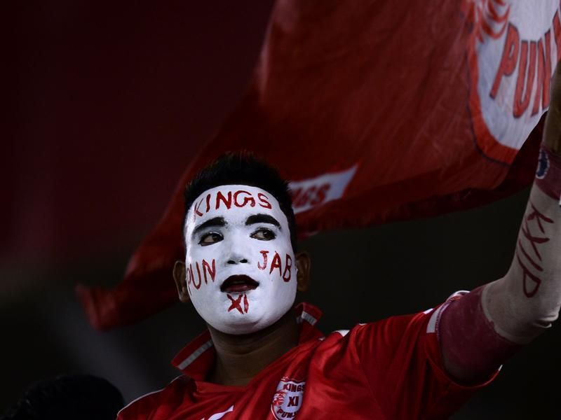 A supporter of the Kings XI Punjab waits for the start of the 2016 Indian Premier League (IPL) Twenty20 cricket match between Gujarat Lions and Kings XI Punjab. (AFP Photo)