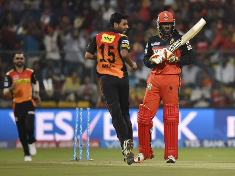 Sunrisers Hyderabad's Bhuveneshwer Kumar celebrates after bowling Chris Gayle around his legs in the second over. (Ravi Choudhary/HT Photo)