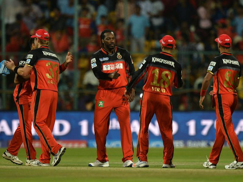 Royal Challengers Bangalore captain Virat Kohli, second from right, and Chris Gayle, third from left, do a jig after to celebrate victory in the 2016 Indian Premier League (IPL) match against Sunrisers Hyderabad at The M Chinnaswamy Stadium in Bangalore on April 12, 2016. (AFP)