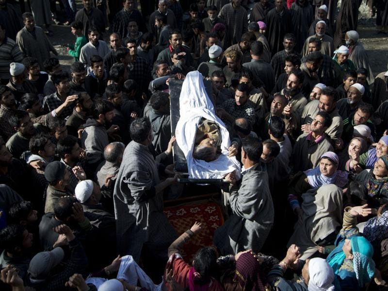 Kashmiri Muslims carry the body of Raja Begum, a 70-year-old woman, who was hit by gunfire on Tuesday, during her funeral procession in Langate some 75 km  north of Srinagar on Wednesday.  (AP)