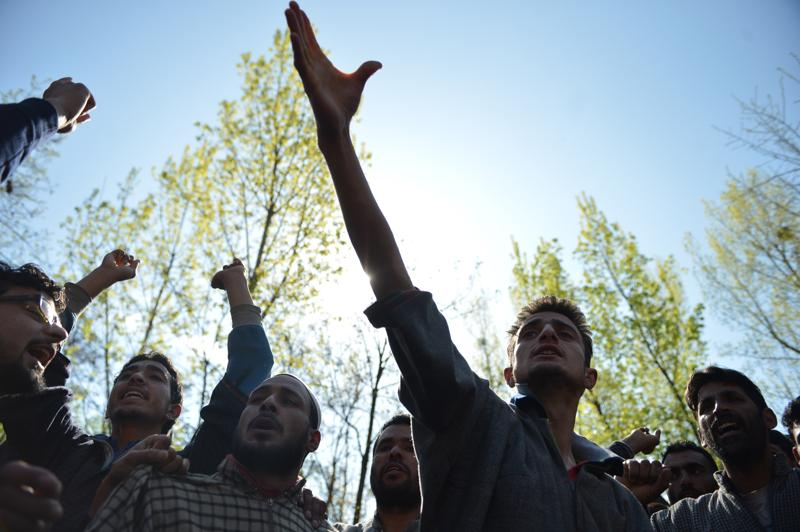 Kashmiri villagers shout pro-freedom slogans during the funeral of Raja Bejum, 70, who was killed in clashes with security forces in Langate near Handwara on Wednesday. At least four have been killed in the clashes between security personnel and protesters enraged by the alleged molestation of a girl. (AFP)