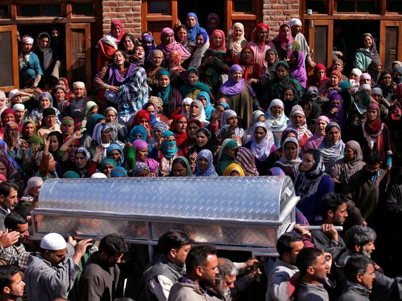 Kashmiri Muslim men carry a coffin containing the body of Raja Begum during her funeral in Langate, north of Srinagar on Wednesday. (Reuters)