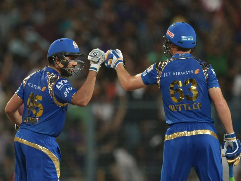 Mumbai Indians' Jos Buttler and captain Rohit Sharma (L) exchange a fist bump. (AFP)