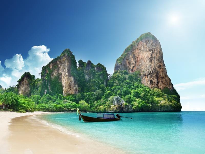 Railay Bay, Thailand: With colourful long-tail boats pulled up on the golden sand and jungly cliffs looming above, exotic photo-ops are everywhere. Adding to the mystique? It's accessible only by boat. Plus, right on Railay is the Rayavadee Resort, covered in palm trees and tropical blooms, with two-story teak-filled bungalows.   (Shutterstock)