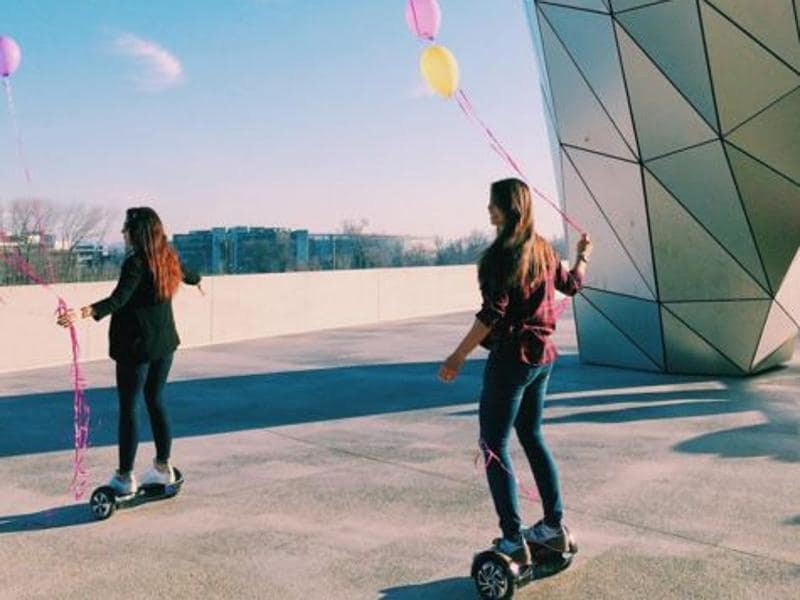 These two girls outside Musée des Confluences in Lyon, France are on hoverboards with baloons and make for a perfect Instagram post. (Instagram/mline17)