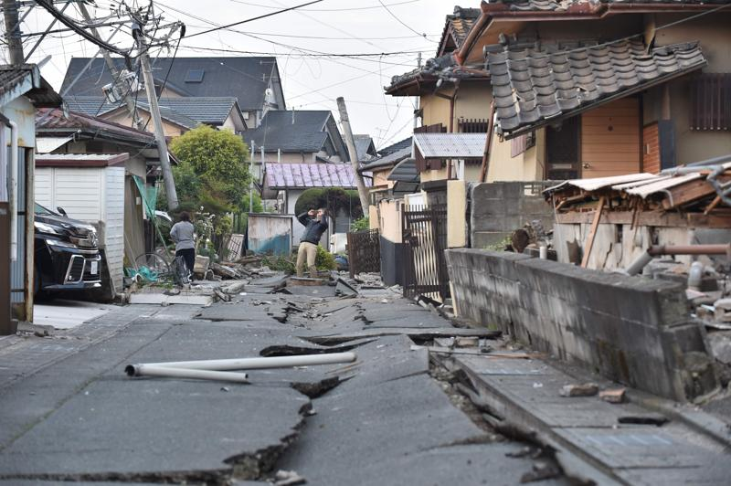 Crack in the ground caused by the earthquake are seen in Mashiki, Kumamoto prefecture. (AFP)