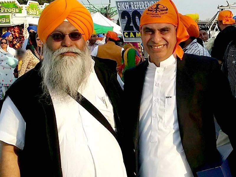 Pakistan's Consul General in Toronto Asghar Ali Golo with Sukhminder Singh Hansra, a supporter of Khalistan. A poster for a referendum for a Sikh homeland is seen in the background. (HT Photo)