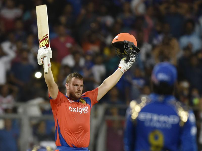 Aaron Finch raises his arms in celebration after hitting the winning runs. (Satish Bate/HT Photo)